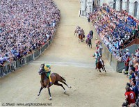 The Palio race at the Casato Bend