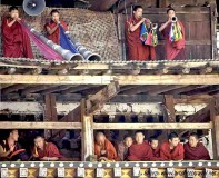 Monks and ceremonial horns, Paro Tsechu