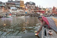 Offering a candle tribute river Ganges varanasi india